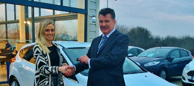 Cambria Automobiles' CEO Mark Lavery hands over the keys to a valued guest for her new Ford car at Invicta Ford Ashford
