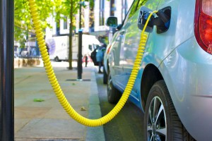 An-Eco-Electric-car-is-re-charged-from-city-street-power-point
