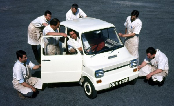 Ford Engineers in aprons inspect the Ford Comuta